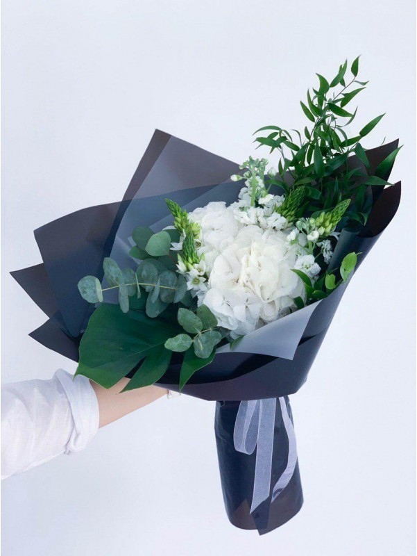 Stylish bouquet of hydrangea and greenery in a black package 'Black mood' by Kiwi Flower Shop